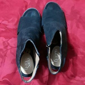 Franco Sarto peep-toe open back booties.